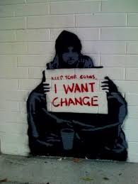 I think that the artist's message is that they want change in the world. This picture shows a poor man sitting on the side of the road begging for fairness and change in the world (instead of money).